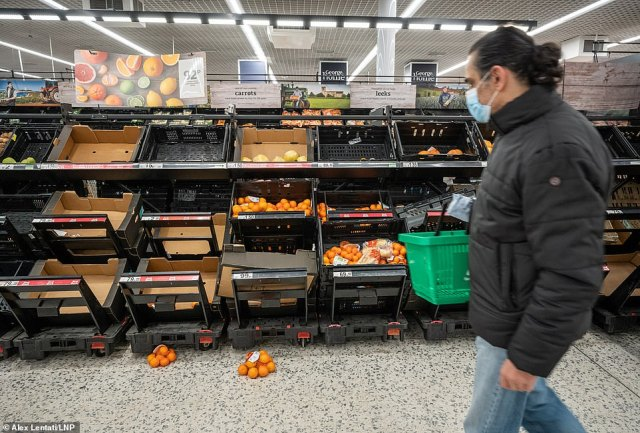 Shoppers look at empty shelves in the fruit and veg aisles at Asda in London this afternoon.Industry insiders warned that there are several products most at risk of shortages