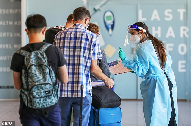 Victoria has recorded zero new community cases of Covid-19 after fears an infected teenager who visited Sydney could have spread the virus. Pictured: Passengers arriving from Sydney are tested for COVID-19 at Melbourne Airport on Sunday
