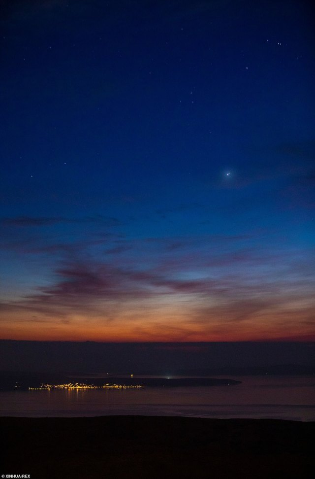 The conjunction of Jupiter and Saturn is seen after sunset above Split, Croatia. The planets appeared closer to each other in the night sky tonight than they have in 800 years