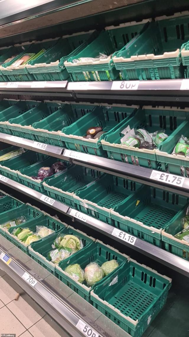 The shelves were already emptied of some fresh produce at the Tesco Local store in Wandsworth, London, this morning