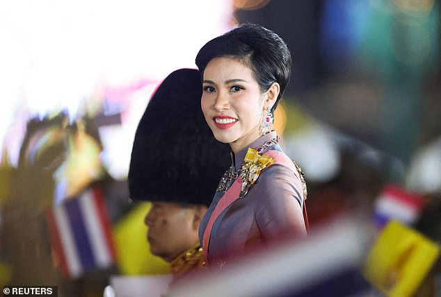 Thailand's Royal Noble Consort Sineenat Wongvajirapakdi attends a candlelight vigil to remember the birthday of Thailand's late King Bhumibol Adulyadej, outside the Grand Palace in Bangkok, Thailand, December 5, 2020