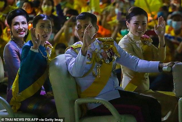 Thailand's King Maha Vajiralongkorn talks to Princess Bajrakitiyabha Mahidol (second left) as they sit with Queen Suthida (right) and royal noble consort SineenatWongvajirapakdi (left) in a golf buggy in Bangkok earlier this month