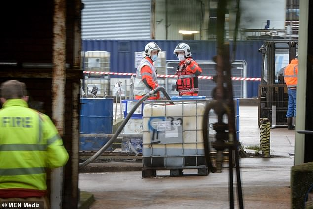 Rescue teams cordon off the area at the industrial site as a man is taken to hospital with 'significant burn injuries'