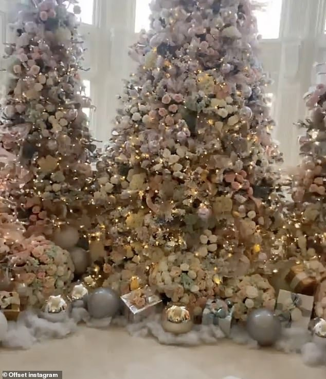 Lots of trees:Offset, who was not pictured in the video, was heard saying: 'How you like Christmas trees going crazy? Five piece'