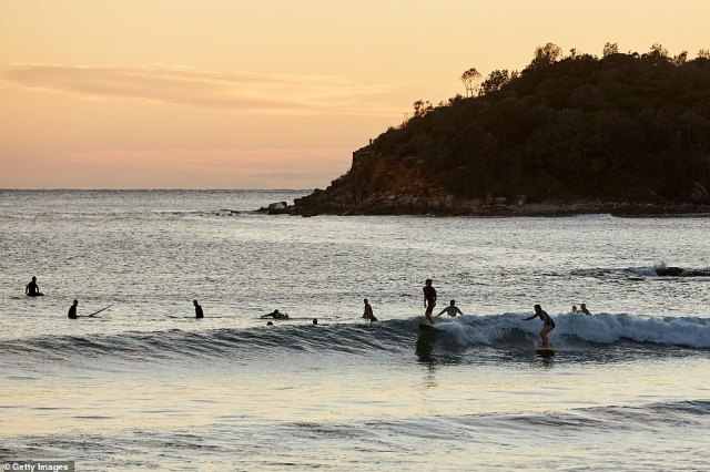 Surfers made the most a quiet Manly Beach on Wednesday morning. Residents were placed on lockdown with unlimited exercise allowed