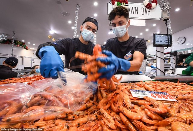 Staff at work before Christmas at the Sydney Fish Market on Wednesday as residents stocked up on food before the big day