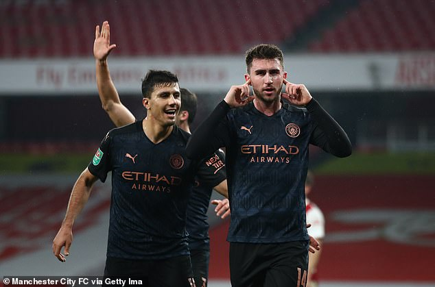 Aymeric Laporte (right) added gloss to the scoreline by adding City's fourth of the evening