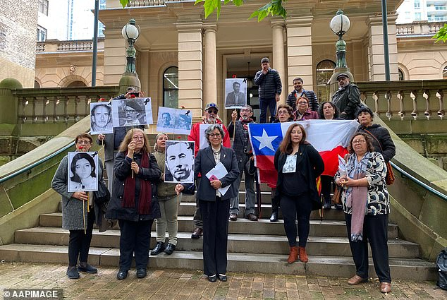 Pictured: Supporters of those who disappeared in Chile in 1970s are seen outside the Sydney Central Local Court on October 29 as a magistrate ruled Rivas was eligible for extradition