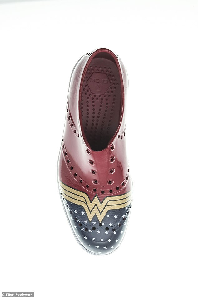 """Design:The Wonder Woman special edition shoe features a, 'ruby red body with the classic golden """"W"""" emblem and star-spangled pattern across the toebox, white midsole, and a yellow outsole,' according to Biion"""