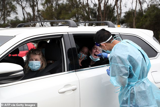The chaos began when new cases emerged in Sydney's Northern Beaches last week (Pictured: Residents are tested for Covid)