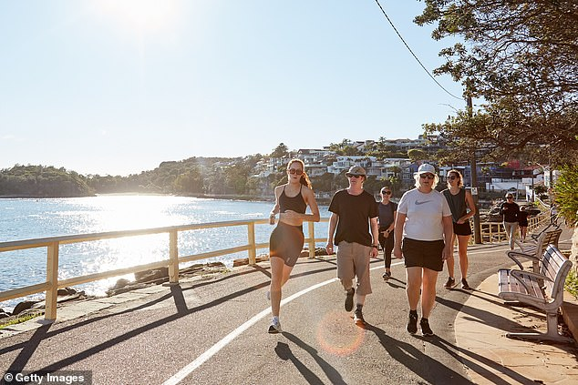 People are seen exercising at Manly Beach on Wednesday. The Northern Beaches is currently in lockdown as it battles a cluster of 97 coronavirus cases