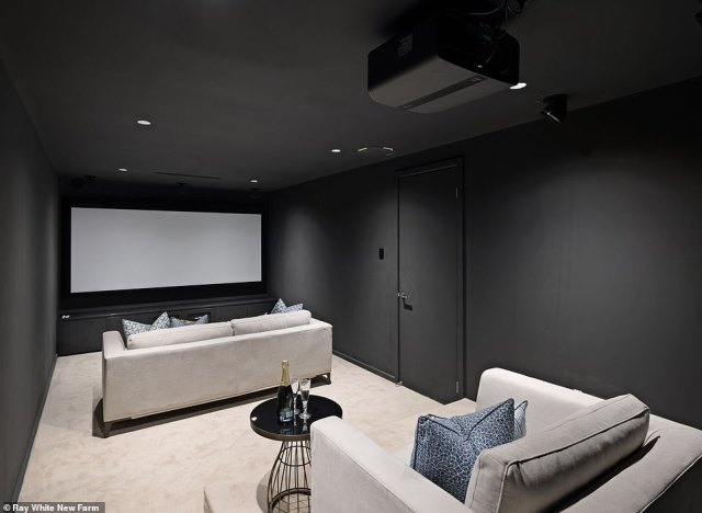 The home's colour scheme appears to have been inverted - only this cinema room looks like it could be in any home