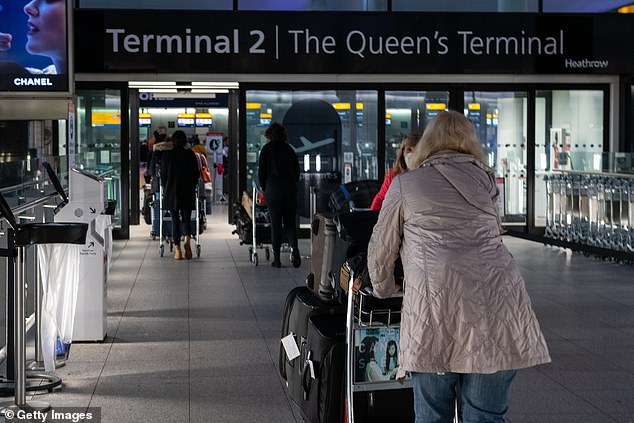 The latest bans could also have a wider impact on British travellers, with Singapore a popular stop-off for those flying from the UK to Australia. Pictured: Passengers arrive at Heathrow Airport yesterday
