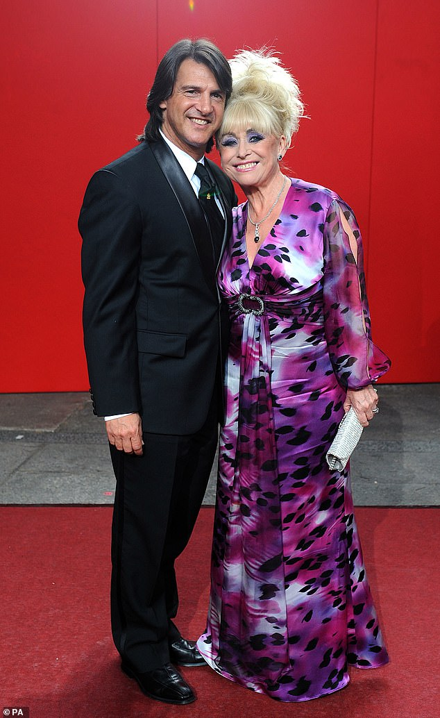 Couple: Scott and Barbara married in 2000. She died at aged 83 following her battle with Alzheimer's disease on December 10 (pictured together in 2009)