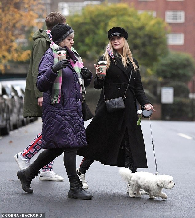 Family time: Laura had her mother Carmel in tow with her as they took the dog for a walk