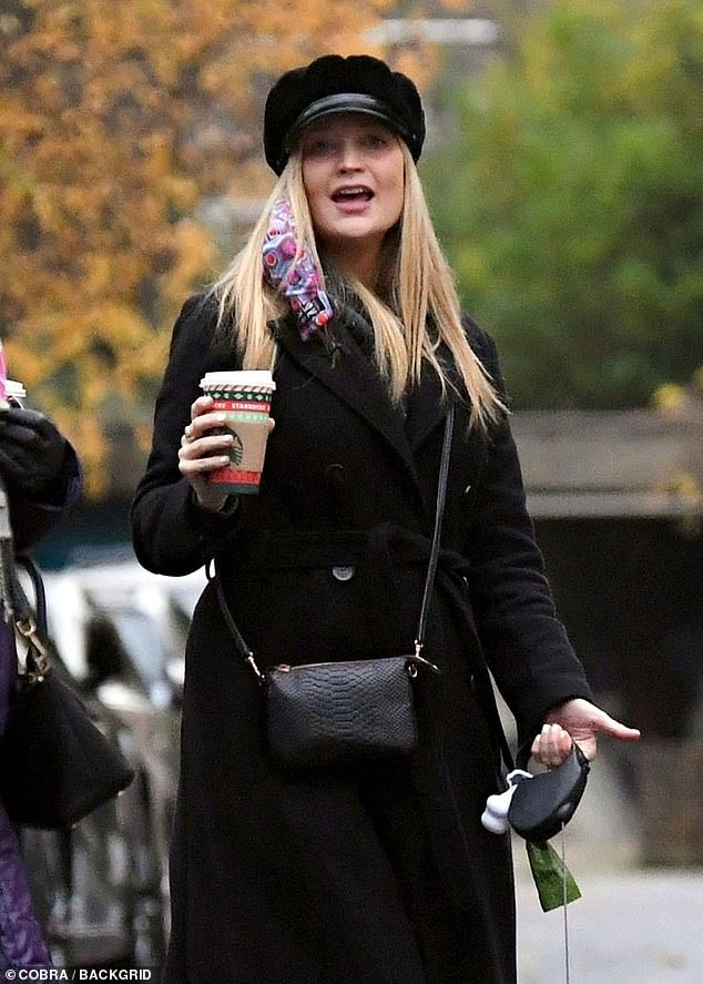 Happy time: Laura Whitmore was seen out for the first time since announcing her pregnancy on a walk with her husband Iain Stirling and mum in London on Wednesday