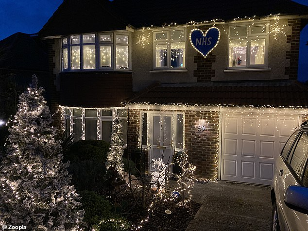 Another house, in Redhill, the South East, aptly placed a light up heart around the NHS sign (pictured)