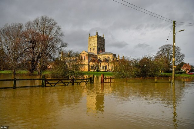 Floodwater surrounding Tewkesbury Abbey, Gloucestershire, which remains open despite the high surface water surrounding it, more wet weather is expected in the coming days