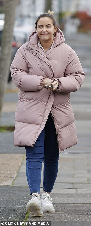 Feeling the December chill: The actress wrapped up warm in the dreary Essex weather, donning a huge padded pink coat
