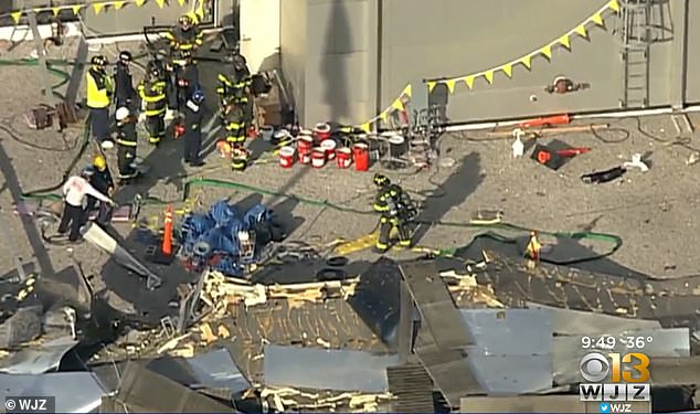 According to Baltimore Fire, the explosion caused the roof to partially collapse on the building (pictured)