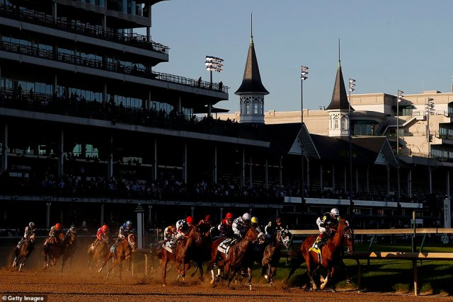 Authentic #18, ridden by jockey John Velazquez leads the field around the first turn during the 146th running of the Kentucky Derby at Churchill Downs on September 05, 2020 in Louisville, Kentucky. The 146th running of the Kentucky Derby was held without fans due to the ongoing COVID-19 pandemic