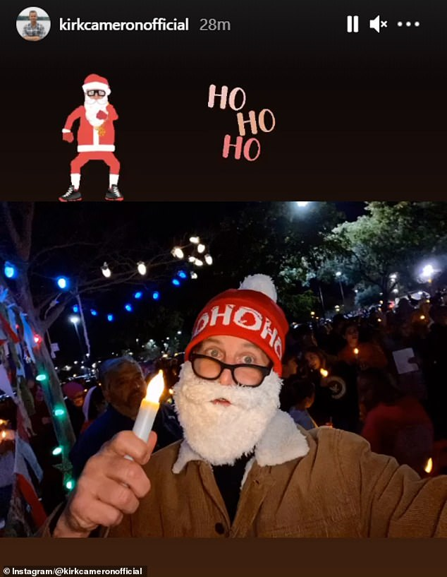 Cameron wore a Santa Claus beard during the mask-free Christmas carols protest