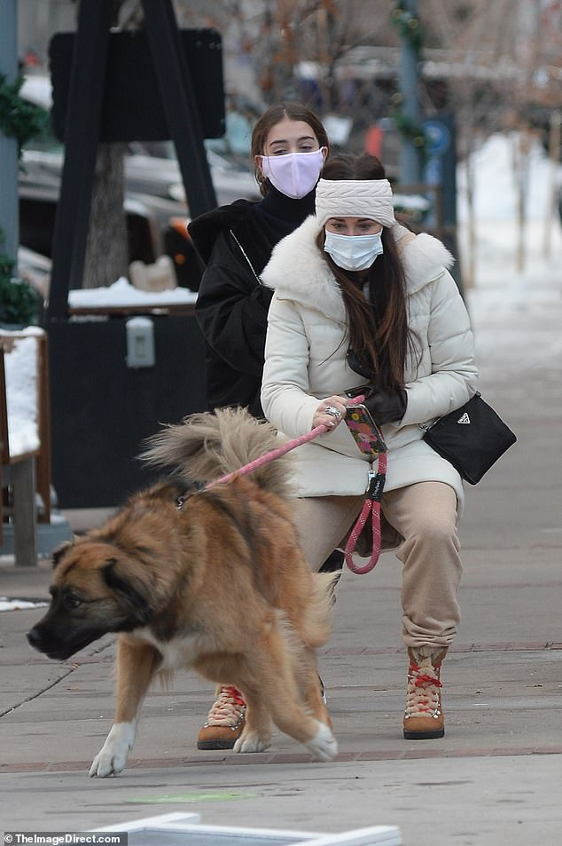 Precious pup: Kyle was seen with her daughter Portia and their family dog during a walk in Aspen, Colorado on Wednesday