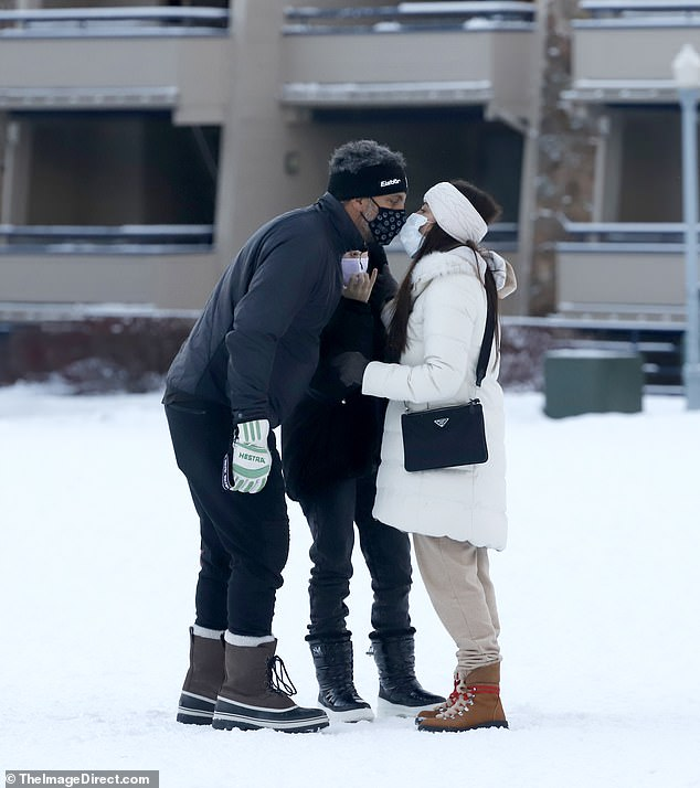 Kyle Richards and husband Mauricio Umansky share a masked kiss while out and about in Aspen
