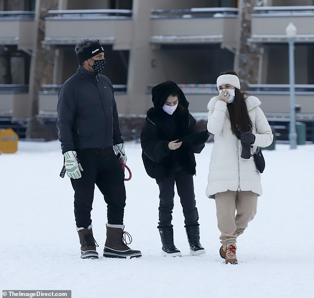Family:The 51-year-old star looked chic in her luxe snow ready look during her PDA moment with Mauricio, 50