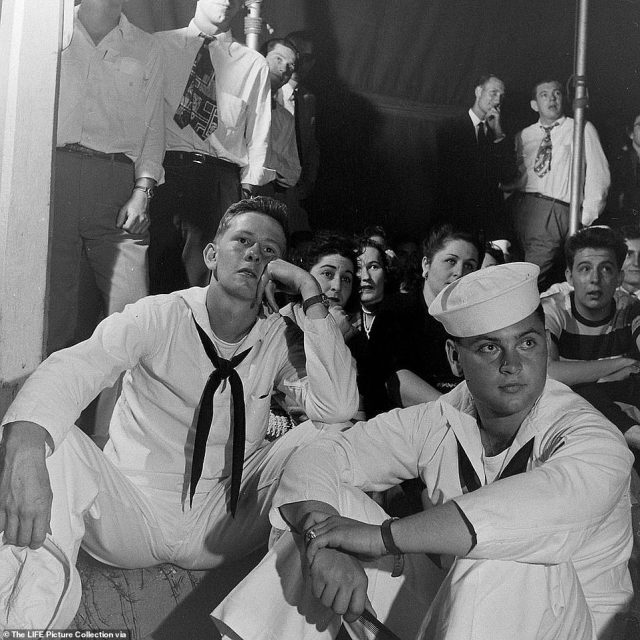 Sailors in the audience are spellbound by the Gypsy Rose Lee burlesque show in Memphis. After headlining a four-year-long residency at Minsky's, Gypsy was invited to perform at the Irving Place Theater - a high-class playhouse patronized by American aristocracy where she rubbed shoulders with members of cafe society, like 'the Otis Chatfield-Taylors, gossip columnist Walter Winchell and visiting English titles like the Earl of Gosford.' This afforded  Gypsy a colossal 17-room apartment in Gramercy, a wardrobe full of bespoke Charles James gowns and a custom Rolls Royce