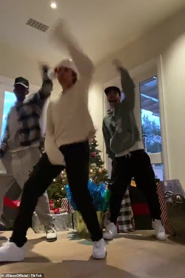 Arms up: The guys got their arms up in the air while performing to a Christmas song