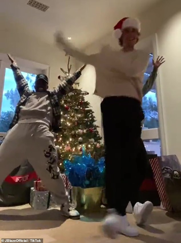 Arms swinging: The Sorry singer swung his arms while dancing to Jingle Bell Rock