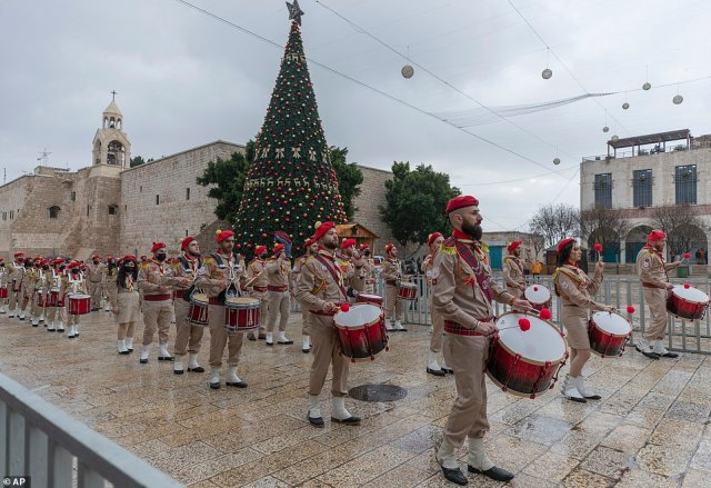 BETHLEHEM: Palestinian scout bands parade through Manger Square at the Church of the Nativity in Bethlehem on Christmas Eve