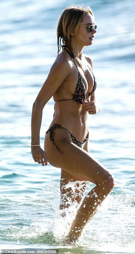 Kimberley Garner flaunts her toned physique in a TINY animal print bikini in Barbados