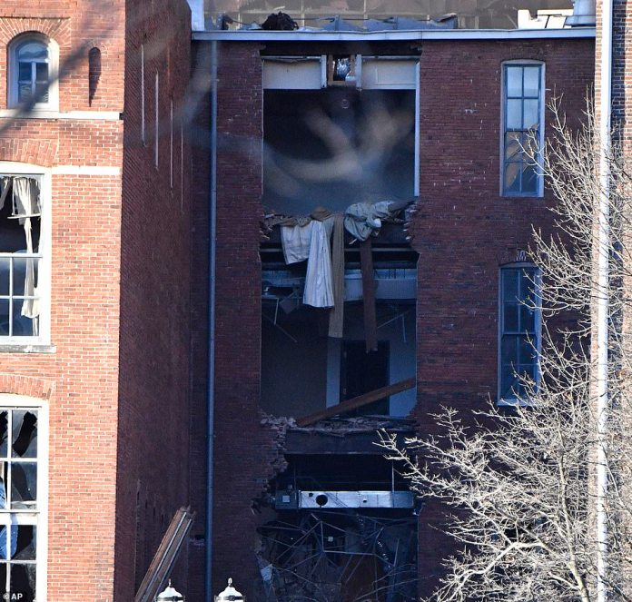 A building is damaged near the area where an explosion was reported on Friday, Dec. 25, 2020 in Nashville, Tenn. Buildings shook in the immediate area and beyond after a loud boom was heard early Christmas morning
