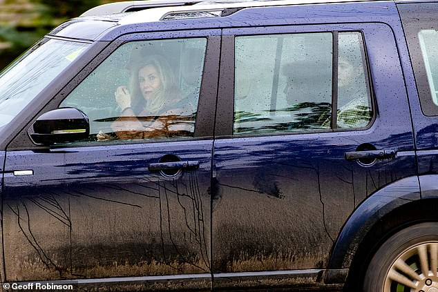 Sophie and Prince Edward arrive in their Land Rover for the service, with their children sat in the back of the car