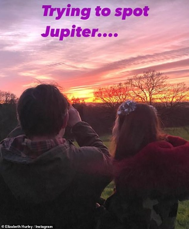 Appreciating the view: The model, 55,also shared a snap of her relatives admiring the setting sun from a rural location which she captioned: 'Trying to see Jupiter'