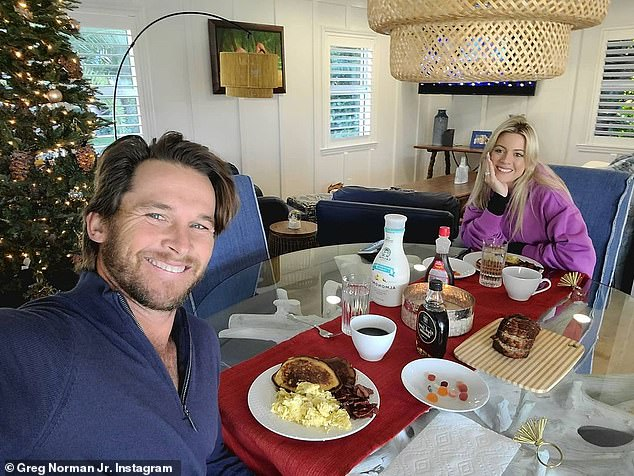 Norman Jr. and his partner Michelle were also forced into isolation for Christmas after testing positive to coronavirus. 'Michelle and I unfortunately are wrapping up the year with a positive diagnosis of Covid. YA. No Xmas with the family,' he wrote on Instagram with this picture