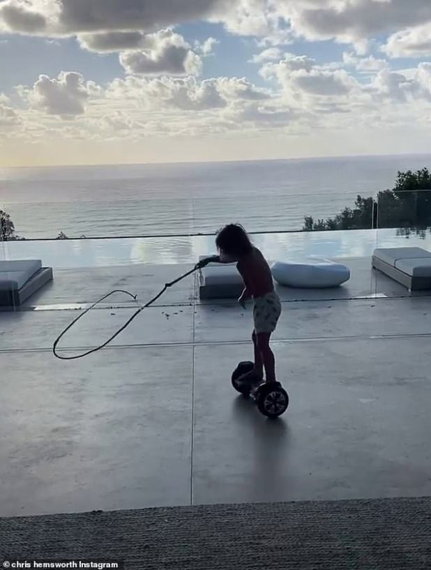 What a gift!  It appears that the doting parents split up on a hoverboard for their little ones, and an Indiana Jones-style whip, which the young boy swung around his head as he glanced around the backyard