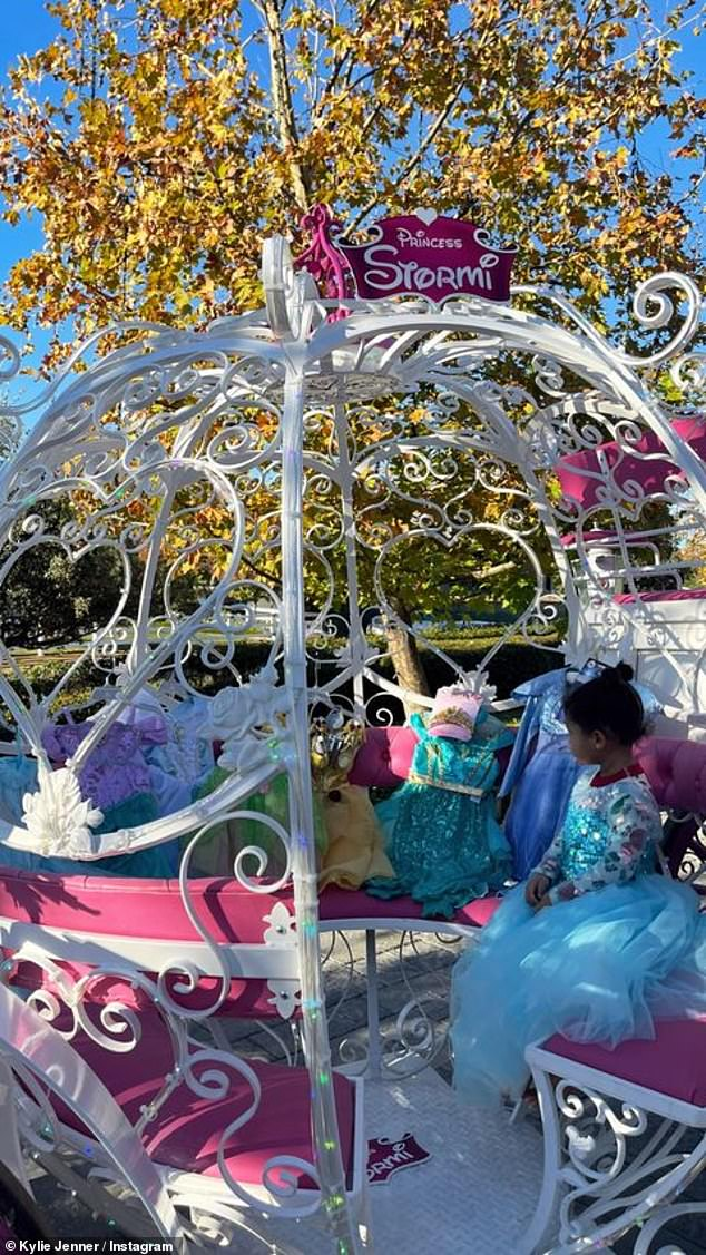 Sweet:Sporting her dress of choice, Kylie captured a candid photo of Stormi sitting inside her princess-approved carriage
