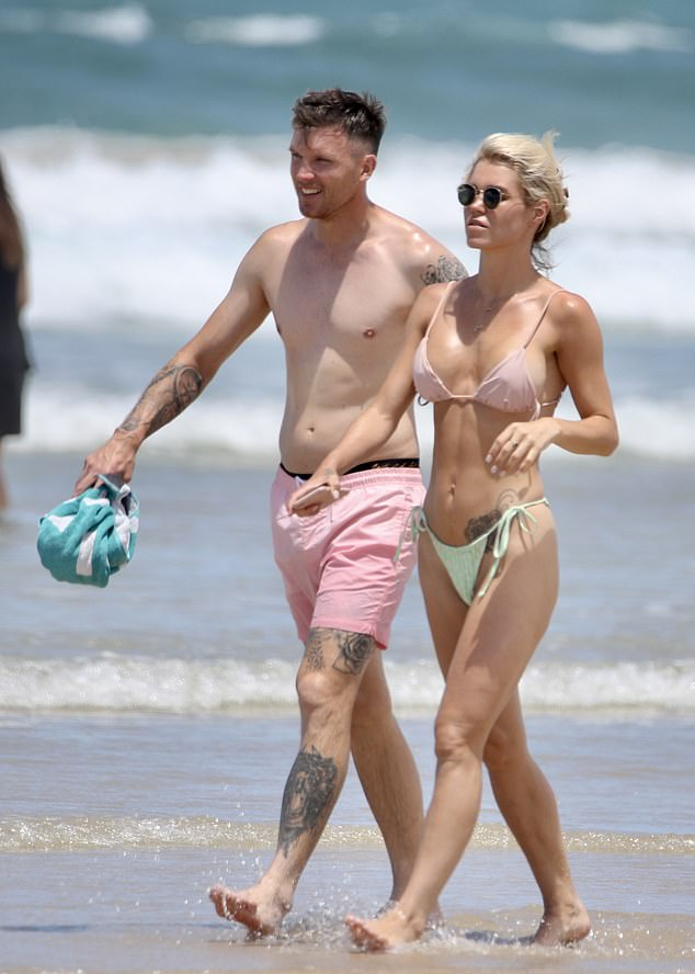 Bachelor's Simone Ormesher flaunts her bikini body at Surfers Paradise with her partner Matt Thorne