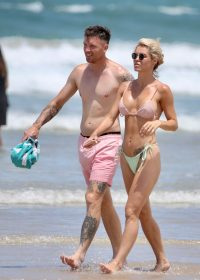 Bachelor's Simone Ormesher flaunts her bikini body at Surfers Paradise with her partner Matt Thorne
