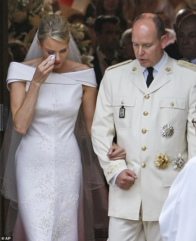 Charlene, who was accused of trying to run away three times before she married, was seen in floods of tears on her wedding day to Prince Albert in 2011