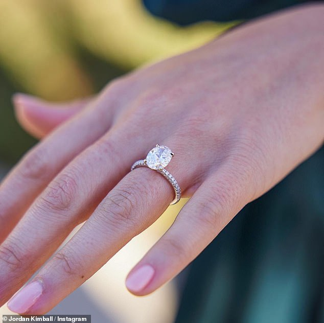 Sparkler: He surprised her as he got down on one knee, popping the question with a 2.35 carat diamond ring inscribed with 'Miss Kimball', as her family watched on, before mass at their church in Houston, Texas