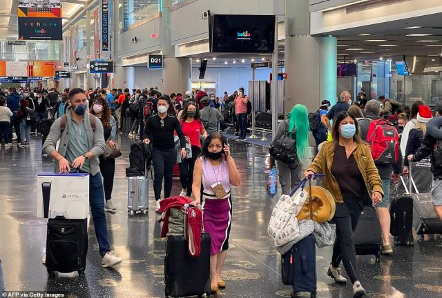 Travelers wear face masks at Miami International Airport on Christmas Eve. Florida has also experienced a surge in COVID-19 cases in recent days