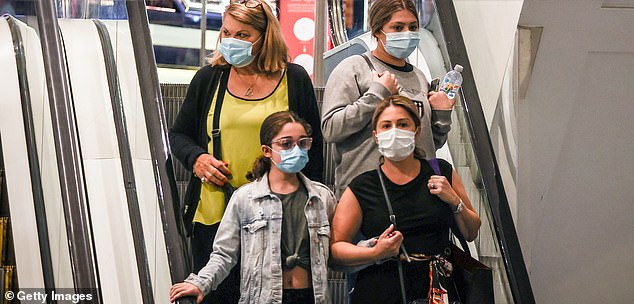 An ACCC spokesman said shops aren't allowed to charge consumers more than what it costs them to process a credit or debit card payment (pictured, shoppers in Sydney on Boxing Day)