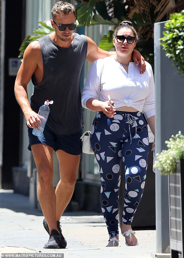 Loved up: Francesca Packer Barham (right) stepped out with her new boyfriend, Adam Cooper (left), on Sunday. The heiress, 26, strolled in the sunshine alongside the Pilates instructor in the upmarket Sydney suburb of Double Bay