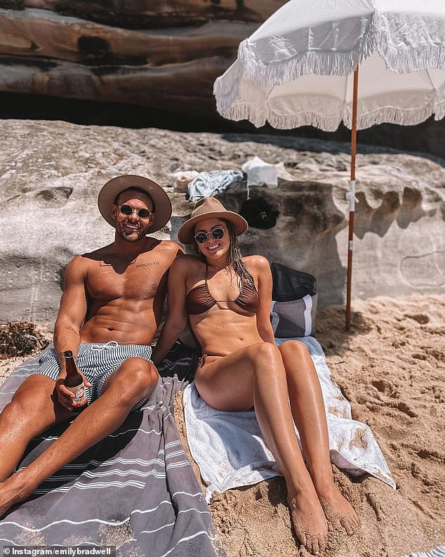 Instagram official! Carlin Sterritt, 31, (left) showed off his gym-honed physique while posing with his new bikini-clad girlfriend, Emily Bradwell, during a beach date on Sunday