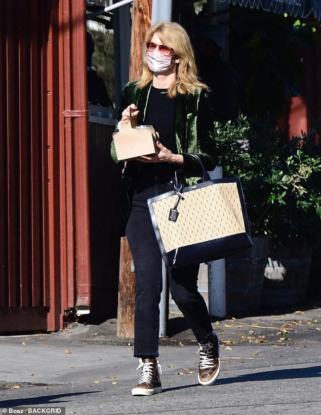 Safety first:Laura Dern put her words into action as she stopped by a local juice shop in Brentwood on Saturday afternoon