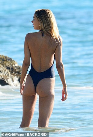 Flaunt it: Kimberley exuded confidence as she paddled in the waters